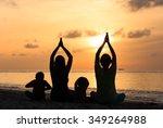 family silhouettes doing yoga...