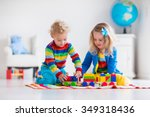 Children Playing With Wooden...