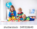 children playing with wooden... | Shutterstock . vector #349318640