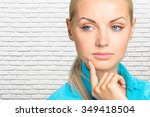 portrait of a thoughtful woman   Shutterstock . vector #349418504