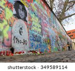 Small photo of PRAGUE, CZECH REPUBLIC - APRIL 23:The Lennon Wall since the 1980s filled with John Lennon-inspired graffiti and pieces of lyrics from Beatles songs on Apr 23, 2013 in Prague, Czech Republic