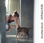 Stock photo young lady with cat on the floor at the kitchen at home 349661438