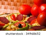 fresh pizza with red tomato - stock photo