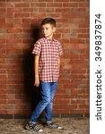cute little boy on brick wall... | Shutterstock . vector #349837874
