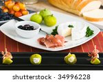 figs appetizer with prosciutto... | Shutterstock . vector #34996228