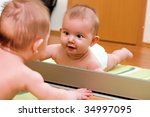 child lying on the floor and... | Shutterstock . vector #34997095