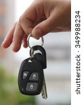 hand holding car key. low depth ... | Shutterstock . vector #349988234