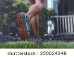 woman running on city park | Shutterstock . vector #350024348