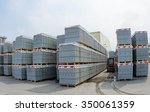 Forklift trucks in stock concrete blocks in outdoor - stock photo