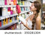 young positive girl buying... | Shutterstock . vector #350281304