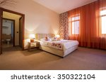 elegant hotel bedroom interior | Shutterstock . vector #350322104