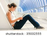 Young pretty girl sitting with a laptop - stock photo