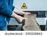 man working with wood machine.... | Shutterstock . vector #350328863