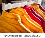 row of winter jackets   photo | Shutterstock . vector #350330150