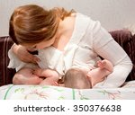 breastfeeding twin babies with... | Shutterstock . vector #350376638