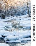 Frozen River In Winter...
