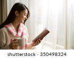 asian woman reading a book and... | Shutterstock . vector #350498324