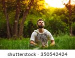 A Bearded Man Is Meditating On...