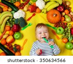 baby surrounded with fruits and ... | Shutterstock . vector #350634566
