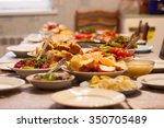 table full of homemade food | Shutterstock . vector #350705489
