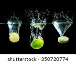 lime splashes on black... | Shutterstock . vector #350720774
