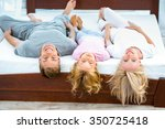 photo of young family of three... | Shutterstock . vector #350725418