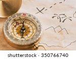 closeup of compass lying over... | Shutterstock . vector #350766740