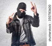 robber making horn gesture | Shutterstock . vector #350783600