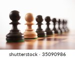 chess the odd one out white pawn in row of black pawns selective focus - stock photo