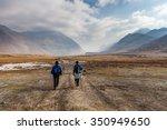 Two People Walking To Mount...