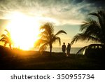 Couple Standing Near Palms On...