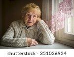 an elderly woman sits alone... | Shutterstock . vector #351026924