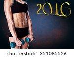 female bodybuilder holding two...   Shutterstock . vector #351085526
