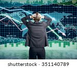 Small photo of Businessman grabs the head concept with business chart on scoreboard