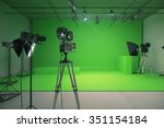 Small photo of Modern empty green photo studio with old style movie camera 3D Render