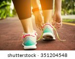 fitness woman tying running... | Shutterstock . vector #351204548