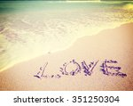 love inscribed in the sand of a ... | Shutterstock . vector #351250304