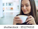 woman drinking coffee in the... | Shutterstock . vector #351274310