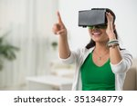 Stock photo asian woman playing game in virtual reality glasses 351348779