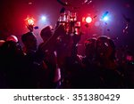Stock photo young friendly people toasting in night club 351380429