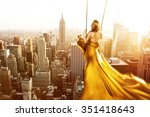 woman on a swing above new york ... | Shutterstock . vector #351418643