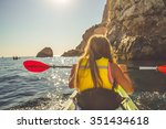 young blonde woman kayaking... | Shutterstock . vector #351434618