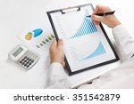 businessman counting losses and ... | Shutterstock . vector #351542879