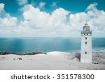 lighthouse and wild coastline | Shutterstock . vector #351578300