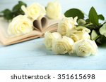 Stock photo bouquet of white roses on blue wooden background 351615698