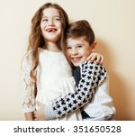 Little Cute Boy Girl Hugging...