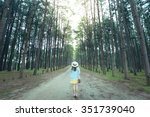 lady is traveling into pine... | Shutterstock . vector #351739040