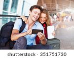 couple in airport using travel... | Shutterstock . vector #351751730