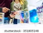 woman holding mobile phone and... | Shutterstock . vector #351805148