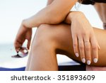 woman in a swimsuit sits on the ... | Shutterstock . vector #351893609